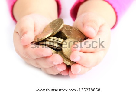 in the hands of a child holding a coin - stock photo