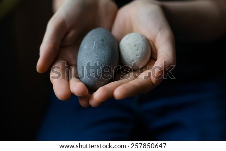 in the hands of sea pebbles