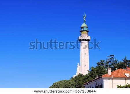 in the italian town Trieste, the lighthouse - stock photo