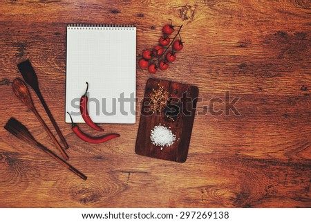 In the kitchen, the restaurant is a notebook student chefs left him lying next to a cutting board - stock photo