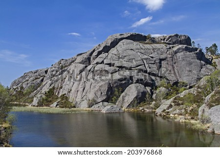 In the Norwegian North Sea Road from  Flekkefjord to Egersund  you can discover beautiful landscapes and countless idyllic lakes, - stock photo