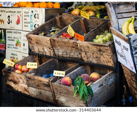 In the photo an old fruit shop in the center of Florence, where the fruit is exposed still in old wooden crates - stock photo