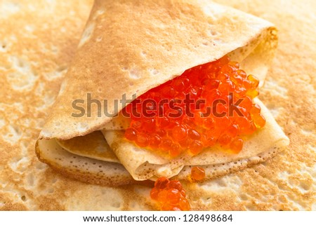 In the pile pancakes with red caviar - stock photo