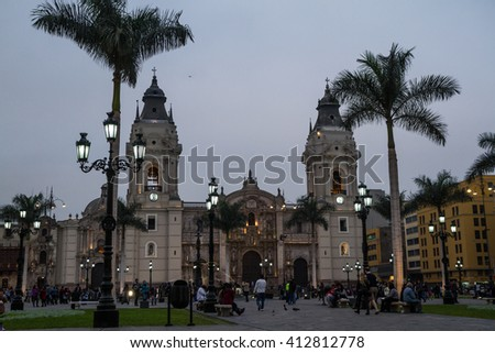 In the Plaza de Armas in the Historic Center of Lima, the Parroquia del Sagrario stands out at sundown.