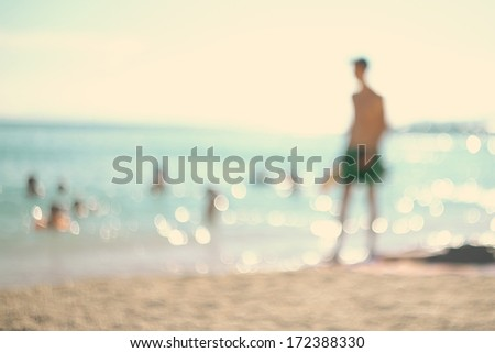 In the summer vacation.Silhouette of a man playing tennis on the beach. - stock photo