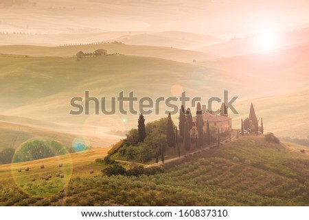 In the tuscan morning, sun and flare - stock photo