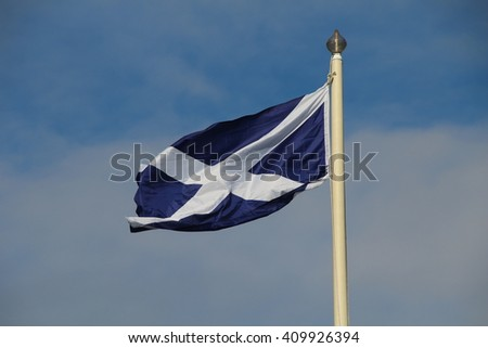 In the wind waving flag of Scotland
