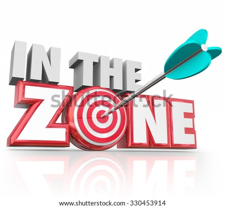 In the Zone words in 3d red letters and an arrow hitting the bulls-eye target to illustrate hitting your stride or on a winning streak - stock photo