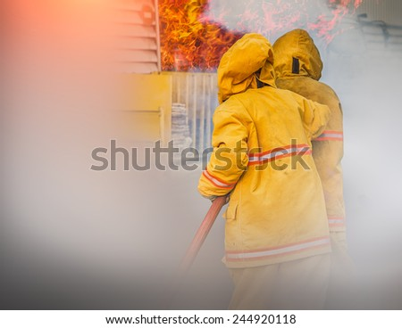 In to the fire, a Firefighter searches for possible survivors - stock photo