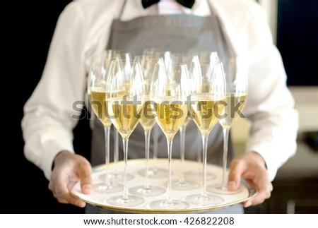 in uniform is serving wine - stock photo
