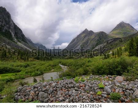 In valley of a mountain river. Zun-Handagay. Tunka Ridge. Sayan mountains. Republic of Buryatia - stock photo
