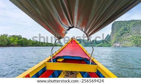 In vintage colorful wooden boat at Phang Nga bay, Thailand - stock photo