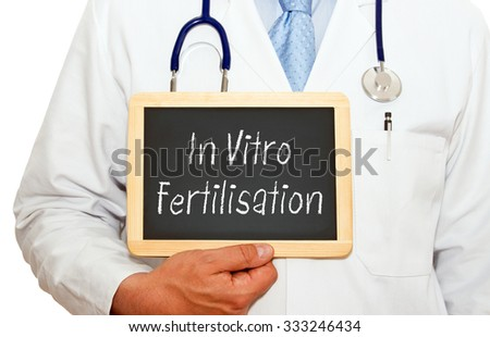 In Vitro Fertilisation - Doctor holding chalkboard with text - stock photo