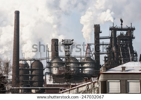 In winter, the smoke rises over the ironworks