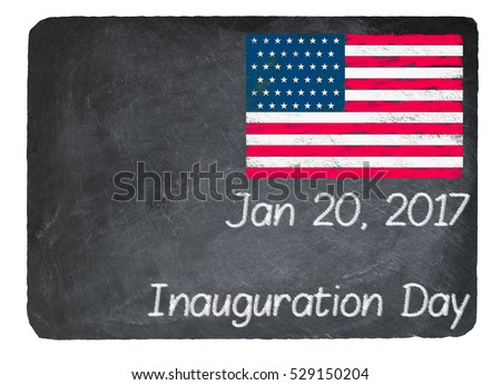 Inauguration Day written in chalk on a chalky natural slate blackboard isolated against white background with copy space