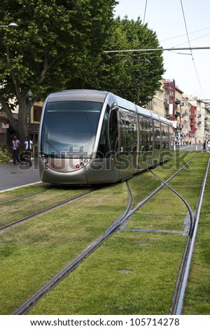 Inbound tram going down Boulevard Jean Jaures on a sunny day. - stock photo