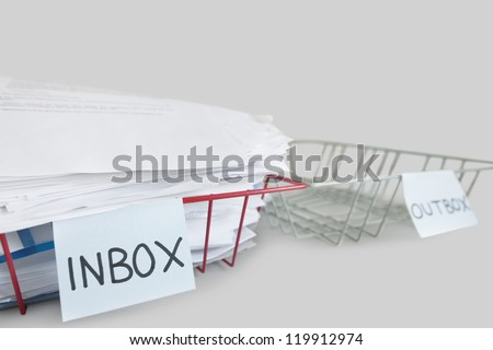 Inbox and outbox trays in an office over white background - stock photo