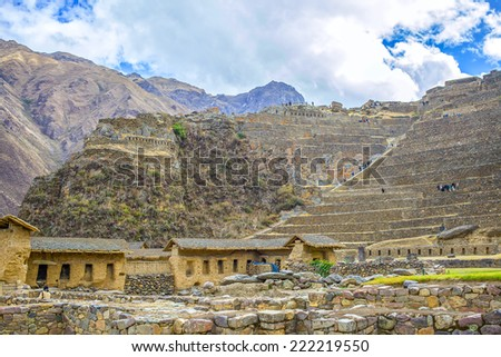 Incan hillside fortress at the town of Ollantaytambo in the Sacred Valley of the Incas (Peru). - stock photo