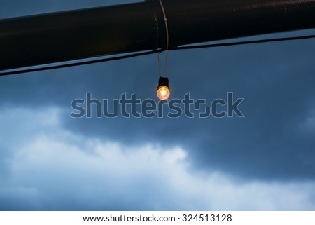Incandescence bulbs with noise and grain on sky background, shallow depth of field, selective focus (detailed close-up shot) - stock photo
