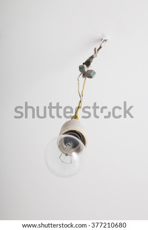 Incandescent electric lamp with holder and wires - stock photo