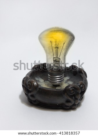 incandescent lamp, mounted in a candlestick