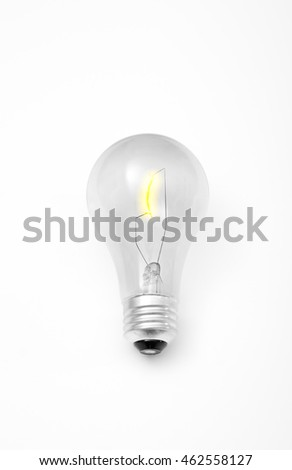 Incandescent light bulb with a glowing yellow filament.