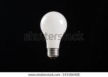 incandescent light buld with a black background