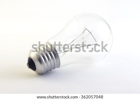 incandescent lighted bulb isolated on pure white - stock photo