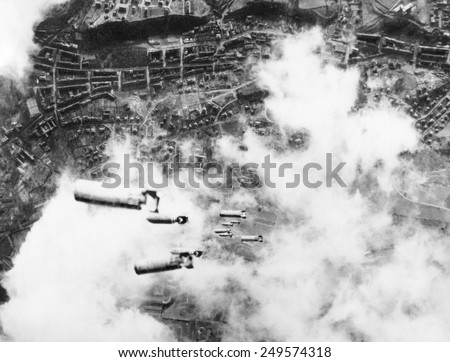 Incendiary bombs fall toward the city of Dresden, Germany. U.S. 8th Air Force heavy bombers attacked the Saxony capital following the Royal Air Force night bombings. - stock photo