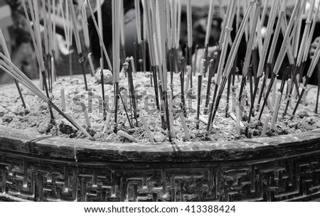 Incense  and candle in the incense burner. Temple in Thailand. selective focus. black and white tone. - stock photo