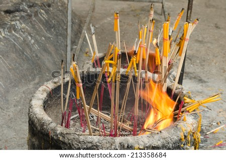 Incense and candles burning - stock photo