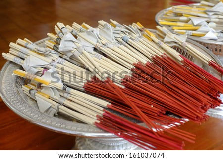 Incense and candles placed on the tray.