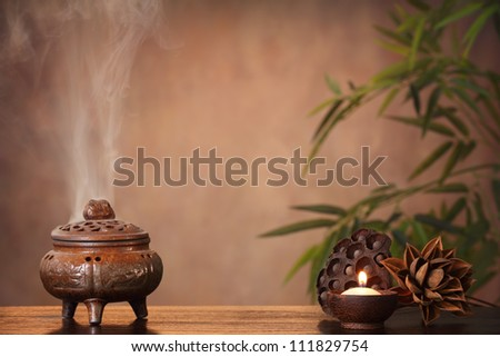 Incense burner and aromatic candle on table, Zen concept. - stock photo
