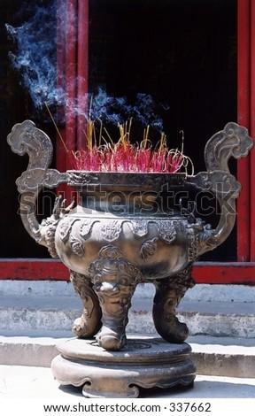 Incense burning outside a Confucian temple, Hanoi - stock photo