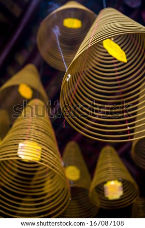 Incense coils hang in the Chinese congregation hall temple in Can Tho, Mekong Delta, Vietnam
