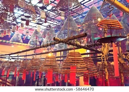 Incense Coils in Man Mo temple. Hong Kong. - stock photo