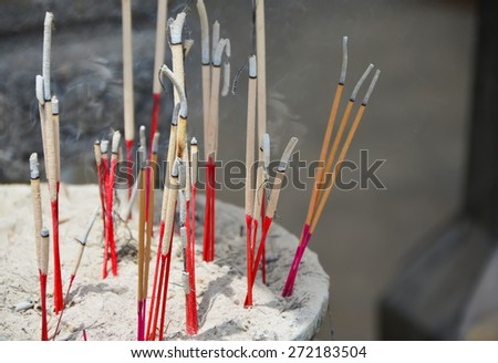 Incense in a Buddhist temple in Thailand - stock photo