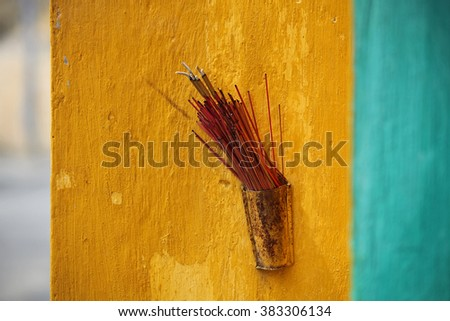 Incense on a colorful wall