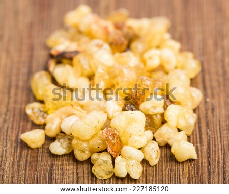 Incense on wooden board - stock photo