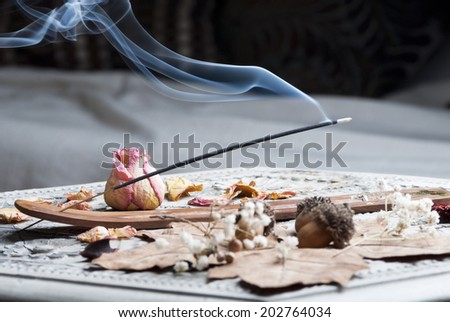Incense stick on wooden table - stock photo