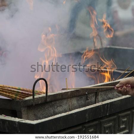 Incense sticks burning at a temple, Lama Temple, Dongcheng, Beijing, China - stock photo