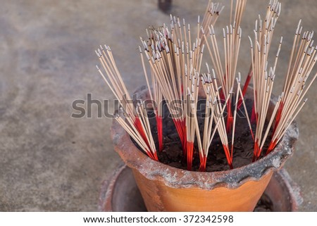 Incense sticks burning in front of Temple in bangkok, Thailand. - stock photo