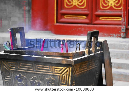 Incense sticks smoking in a lama temple in Beijing
