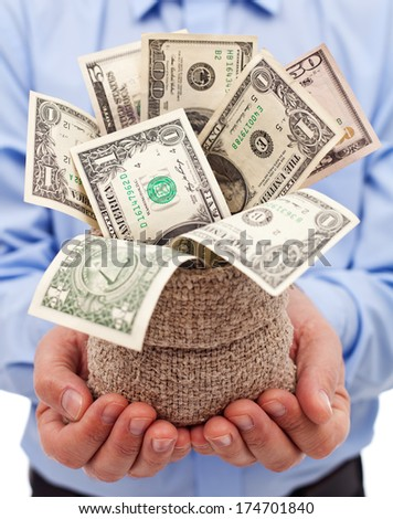 Incentive for businessman - bag full of dollar banknotes in male hands, closeup - stock photo