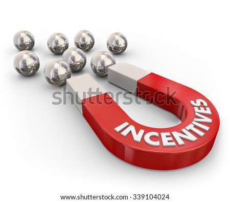 Incentives word on a red metal magnet attracting silver metal ball bearings symbolizing new customers lured by rewards, advertising, promotion, benefits and savings - stock photo