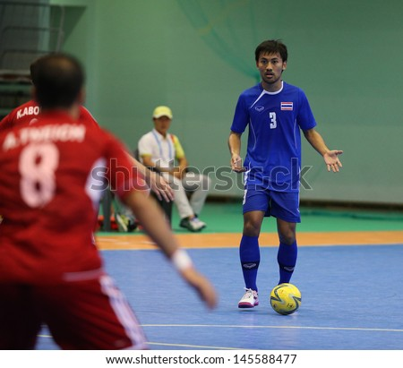 INCHEON - July 3:LAKKA Konghla #3 of Thailand in action during futsal match vs. Lebanon in an 4th Asian Indoor and Martial Arts Games at Songdo Global University on July 3, 2013 in Incheon, Korea.