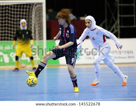 INCHEON - July 5:SEKINADA Minako #9 of Japan in action during futsal match vs. Iran in an 4th Asian Indoor and Martial Arts Games at Songdo Global University on July 5, 2013 in Incheon, Korea.