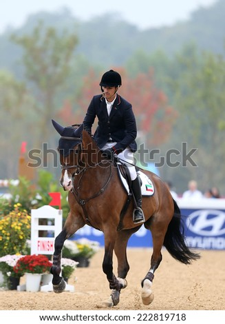 INCHEON - SEP 28:ALI J M Kh H Alkharafi of Kuwait in action during the 2014 Incheon Asian Games at Dream Park Equestrian Venue on September 28, 2014 in Incheon, South Korea.