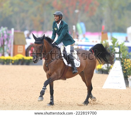 INCHEON - SEP 28:ALMAQADI Salman Hamed S of Saudi Arabia in action during the 2014 Incheon Asian Games at Dream Park Equestrian Venue on September 28, 2014 in Incheon, South Korea.