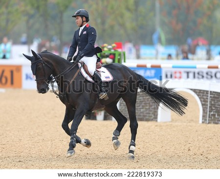 INCHEON - SEP 28:DU VERNET DAVIS Alexander Tai of Thailand in action during the 2014 Incheon Asian Games at Dream Park Equestrian Venue on September 28, 2014 in Incheon, South Korea.